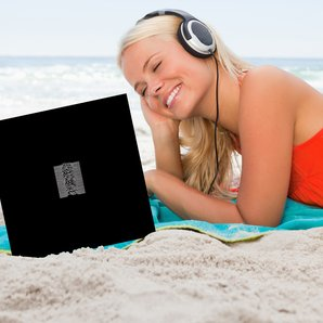 Woman on beach listening to Joy Division's Unknown