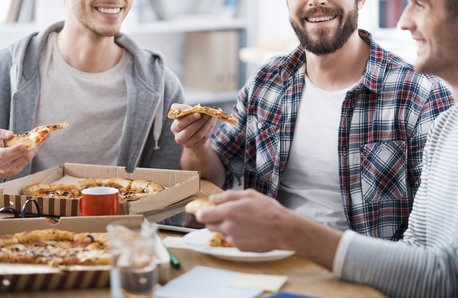 Pizza in the office stock image