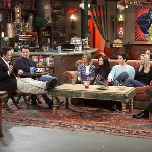 The Friends cast on the sofa in Central Perk