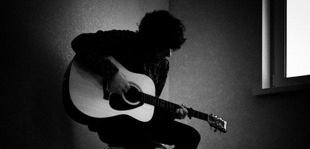 Musician singer guitarist feature