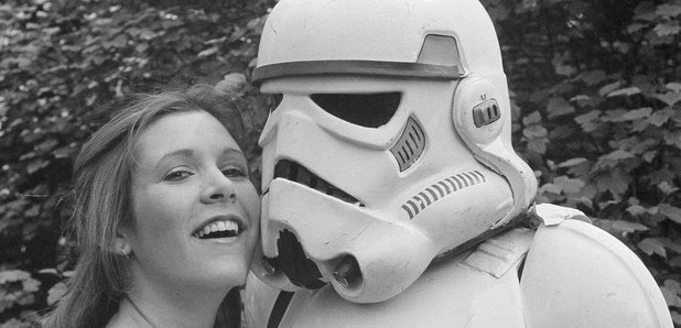 Carrie Fisher posing with Stormtrooper in 1980