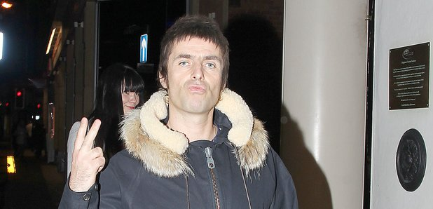 Liam Gallagher with two fingers in Manchester 2013